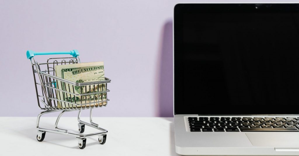 Image of shopping cart and laptop